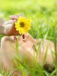 jmw-nov12-newsletter-woman-smelling-a-flower